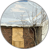 brick house with tarp on roof blount's complete home services fire water restoration termite pest control augusta ga